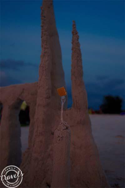 Siesta Beach sand castle as darkness falls