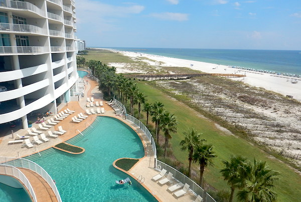 View of the pool and beach at Turquoise Place in Orange Beach