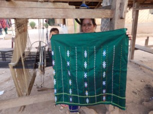 Finished cloth woven on the loom.