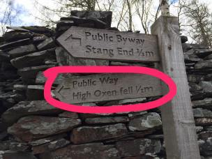 """Walk to the end of the road, until you see this signpost on the right side of the road. Turn right, following the """"High Oxen Fell"""" sign."""