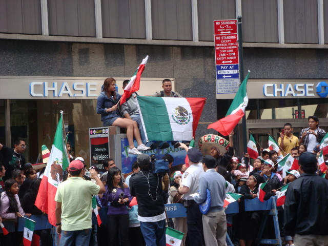 20070916-mexican-day-parade-06-cop-rousting-people.jpg