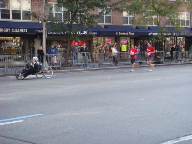 20071104-ny-marathon-17-wheelchair-racer-with-running-escort.jpg