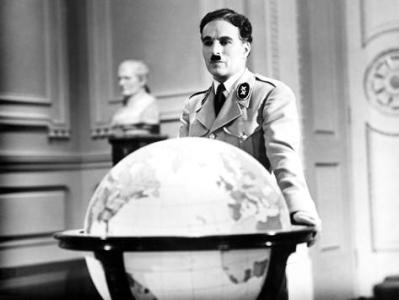 Image of Charlie Chaplin in The Great Dictator, as Adenoid Hynkel playing with the globe of the world.