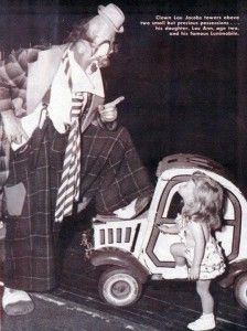Lou Jacobs towering over his clown car … and his daughter