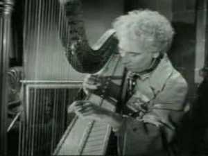 Harpo finds a harp - and plays it