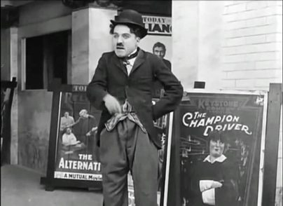 A Film Johnnie (1914) starring Charlie Chaplin, Fatty Arbuckle, Edgar Kennedy, Ford Sterling, Mabel Normand