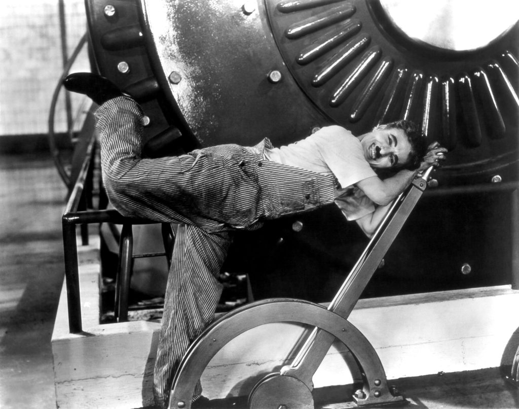 Publicity photo of Charlie Chaplin working in the factory in Modern Times