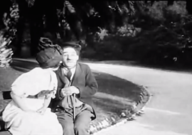 Twenty Minutes of Love - Charlie Chaplin being kissed by a pretty girl