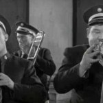You're Darn Tootin' - Stan Laurel and Oliver Hardy playing in the band