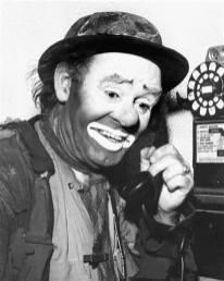 emmett-kelly-phone-smiling