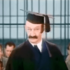 James Finlayson as the teacher at the prison in Pardon Us