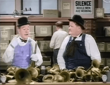 Saps at Sea - Stan Laurel and Oliver Hardy working at the horn factory