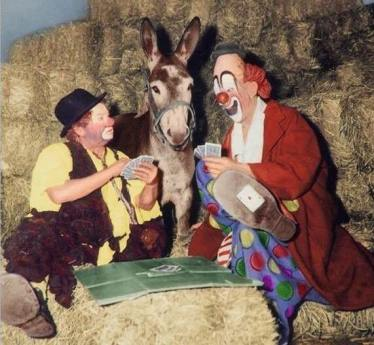 Otto Griebling, Lou Jacobs, and a mule playing cards. I'm betting on the mule ...