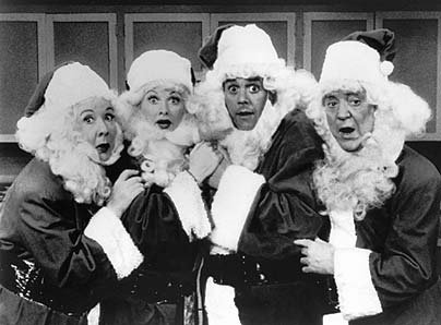 The cast of I Love Lucy in Santa suits for their Christmas special