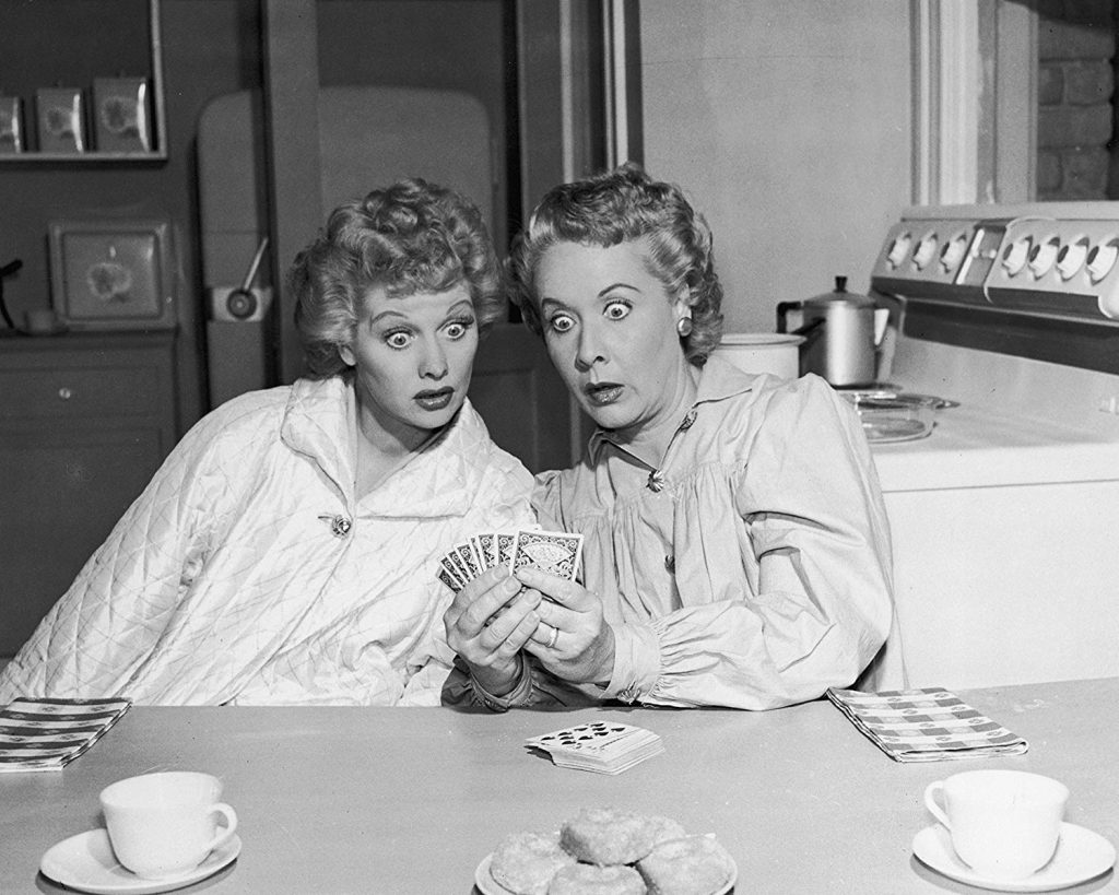 Lucille Ball and Vivian Vance at the kitchen table -- what's in those cards?