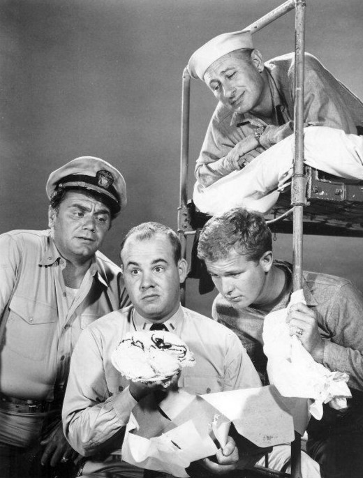 McHale's Navy (1962) - McHale (Ernest Borgnine), Gruber (Carl Ballantine, in top bunk), and Christie {Gary Vinson, seated on lower bunk), have a look at the cake Ensign Parker (Tim Conway) received