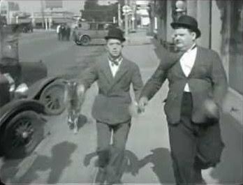 "Stan Laurel and Oliver Hardy being chased by Penelope the Goat in ""Angora Love"""