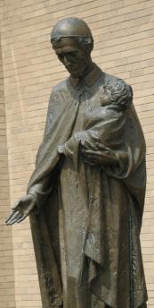 """Pat Griffin """"reads""""  a St. Vincent statue"""