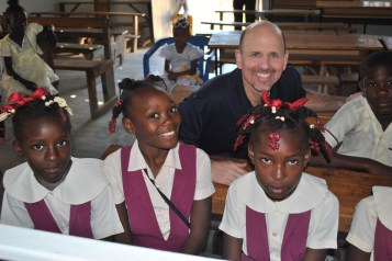 Brother John Skrodinsky is pictured with school children at the Missionary Servants' mission in Haiti in this undated photo. (CNS photo/courtesy Fuzati)