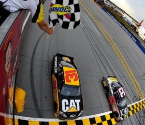 Another example of tandem racing - Clint Bowyer (33) beats drafting partner Jeff Burton (31) to the finish line by .018 seconds to win the Good Sam Club 500 at Talladega Superspeedway. Photo by Jason Smith/Getty Images