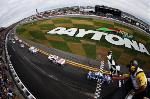 Jimmie Johnson, driver of the #48 Lowe's Chevrolet, races to the finish line to win the NASCAR Sprint Cup Series Daytona 500 at Daytona International Speedway on Feb 24, 2013  Photo - Jared C. Tilton/Getty Images