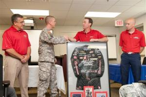 (L-R) Rocky Sickmann, director of military sales for Anheuser-Busch, Major Jason Todd, Kevin Harvick and Major Dan Rooney, founder of the Folds of Honor Foundation Kevin Harvick presents his 2011 Coca-Cola 600 race-winning firesuit to Major Jason Todd of the Warrior Transition Battalion at Fort Bragg on Thursday, May 23, 2013  Photo - Budweiser Racing