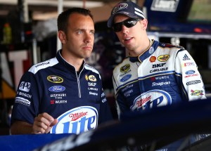 Brad Keselowski, driver of the #2 Miller Lite Ford, talks with crew chief Paul Wolfe in the garage during practice at Dover International Speedway.  Photo - Tom Pennington/Getty Images