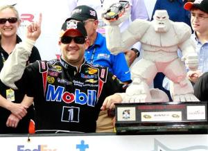 Tony Stewart, driver of the #14 Code 3 Associates/Mobil 1 Chevrolet, celebrates with the trophy in Victory Lane after winning the NASCAR Sprint Cup Series FedEx 400 benefiting Autism Speaks at Dover International Speedway on June 2, 2013  Photo - Sean Gardner/Getty Images