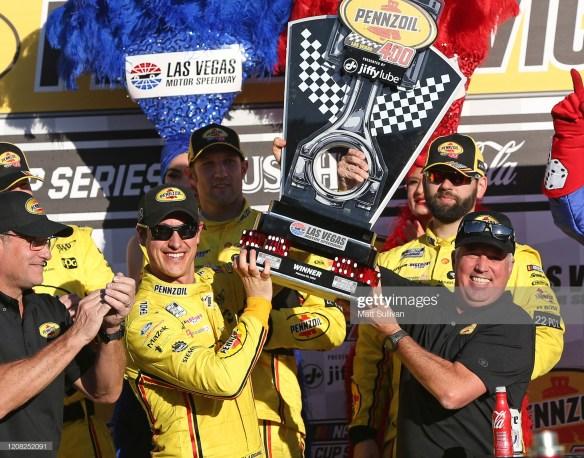 Joey Logano celebrates winning the Pennzoil 400 at Las Vegas Motor Speedway.