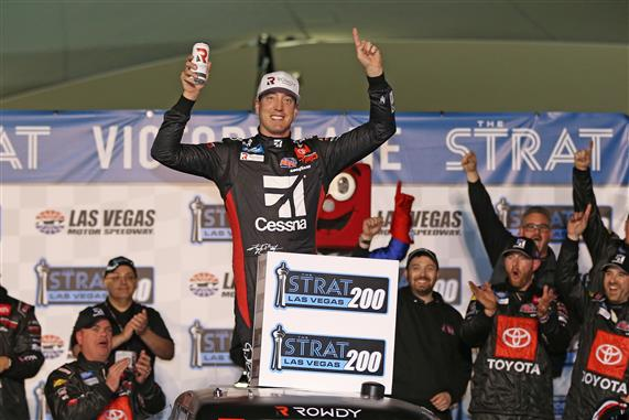 Kyle Busch celebrates in victory lane after dominating the NASCAR Truck Series at Las Vegas Motor Speedway