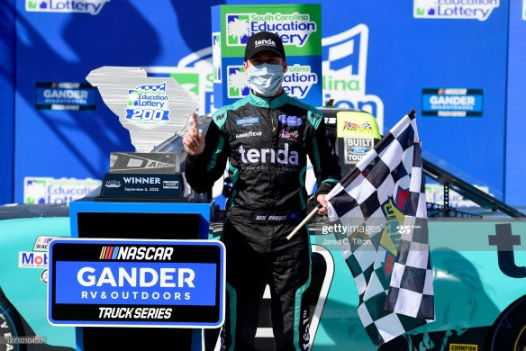 Ben Rhodes uses strategy and an overtime pass to win the NASCAR Gander Outdoors Truck Series South Carolina Education Lottery 200 at Darlington Raceway.