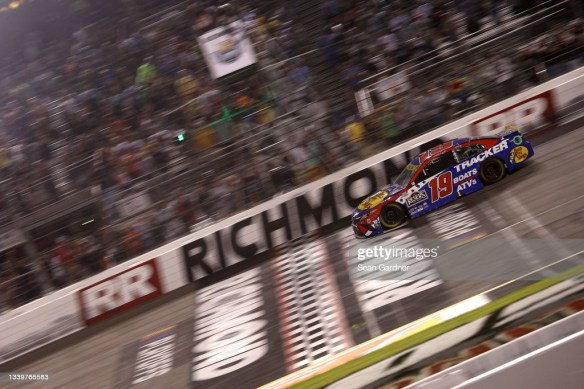Martin Truex Jr edges Denny Hamlin for a playoff victory in the NASCAR Cup Series Federated Auto Parts 400 at Richmond Raceway on Saturday.