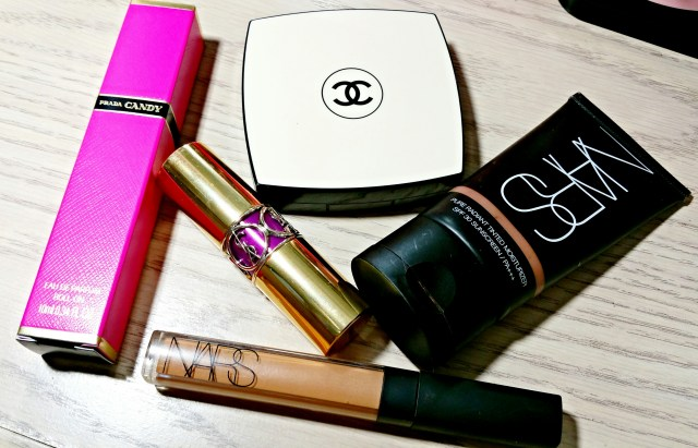 Prada Candy Perfume, NARS Amande Radiant Creamy Concealer, Yves Saint Laurent Shine 19 Fuchsia in Rage, Chanel Les Beiges 70, NARS Polynesia Pure Radiance Tinted Moisturizer