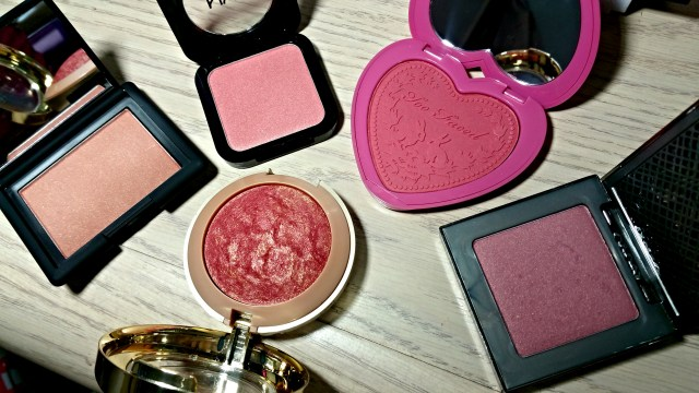 Urban Decay Rapture Afterglow Blush, Milani Red Vino Baked Blush, Too Faced Your Love is King Love Flush Blush, NYX Intuition HD Blush, NARS Love Joy Blush