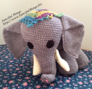 Finished crochet elephant in a standing position.
