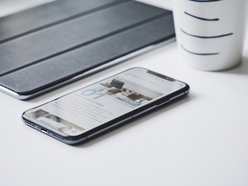 smartphone-laying-on-a-white-table-desk