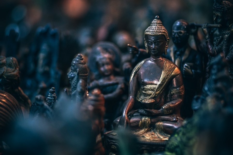 Brass-Statue-of-Buddha-Sitting-Down-with-Golden-Decorations