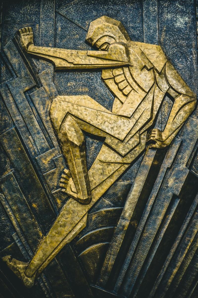 Amazing-Golden-Art-Deco-Sculpture-with-Dark-Background