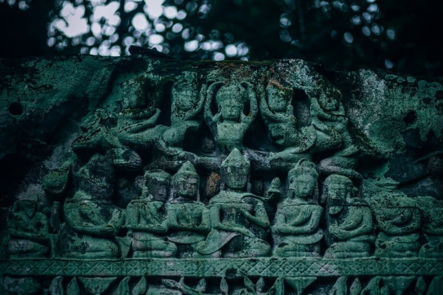 Beautiful-Statues-at-a-Temple-in-Cambodia-Covered-in-Moss