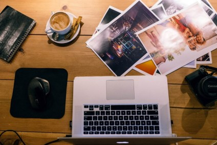 Café-Workspace-with-a-Laptop-Pictures-and-a-Canon-Camera