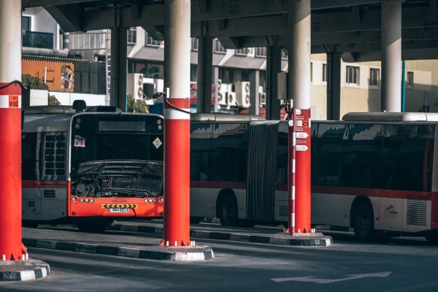 Red-and-White-Public-Transport-Busses-Parked-in-the-Garage