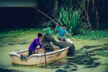Three-Men-in-a-Rowboat-Trying-to-Catch-Fish-in-Cambodia