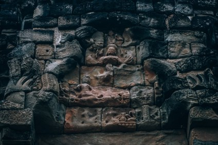 Buddhist-Statue-Carved-in-The-wall-on-the-side-of-Bakong-Temples