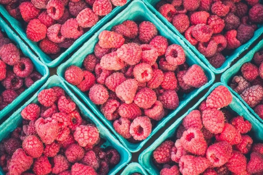 Close-up-shot-of-Fresh-Raspberries-in-Teal-Buckets