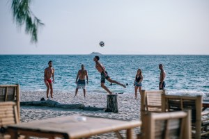 Friends-Playing-with-a-Volleyball-at-The-Beach