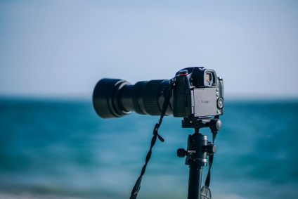 Lumix-Camera-Set-Up-at-the-Beach-with-the-Sea-in-the-Background
