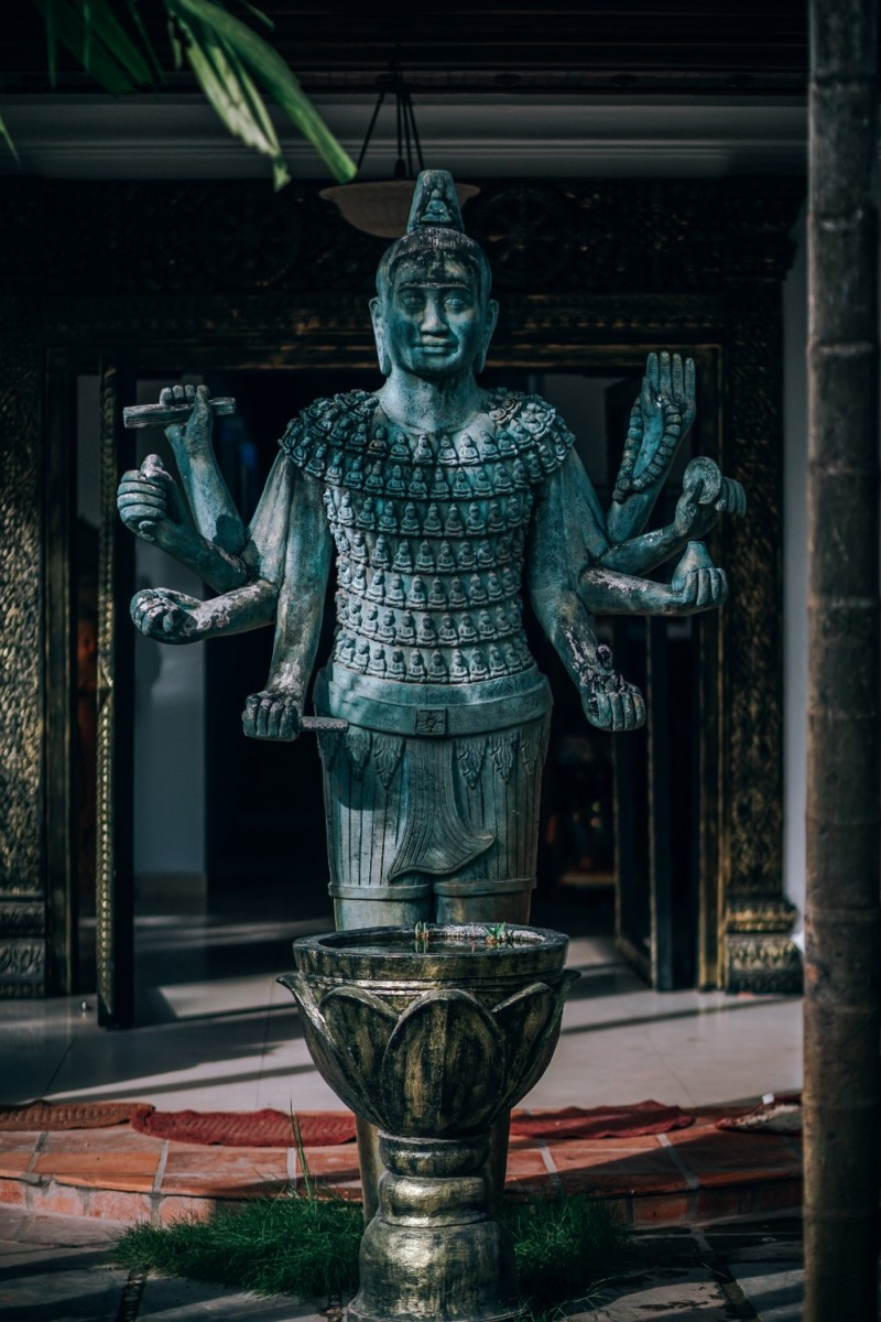 Marvelous-Teal-Statue-of-a-God-with-Multiple-Arms