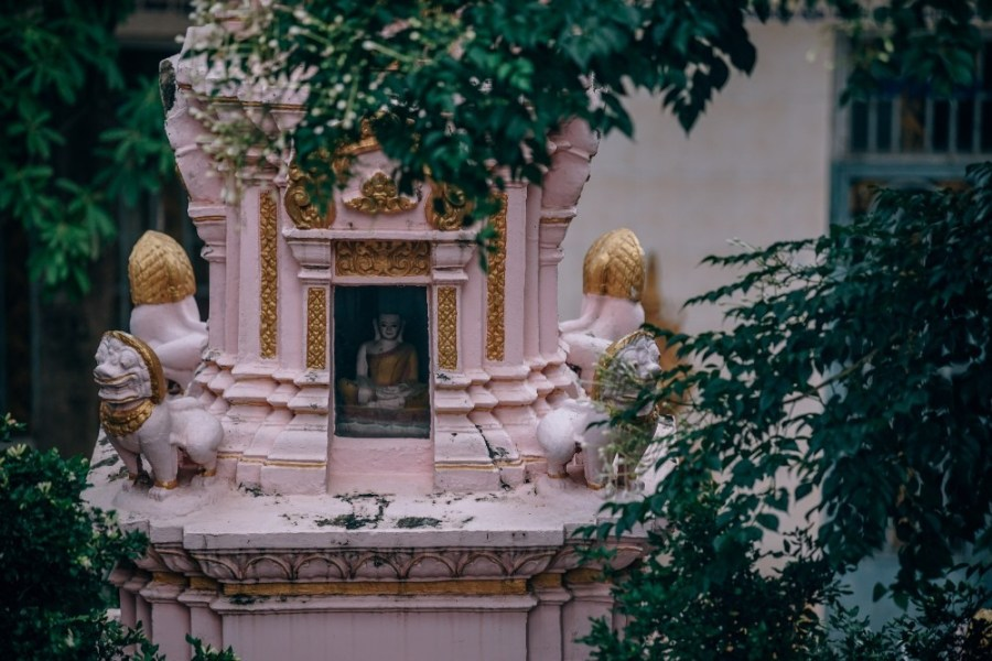 Small-Pink-Temple-with-Golden-Decorations-and-a-Buddha-Statue-Inside