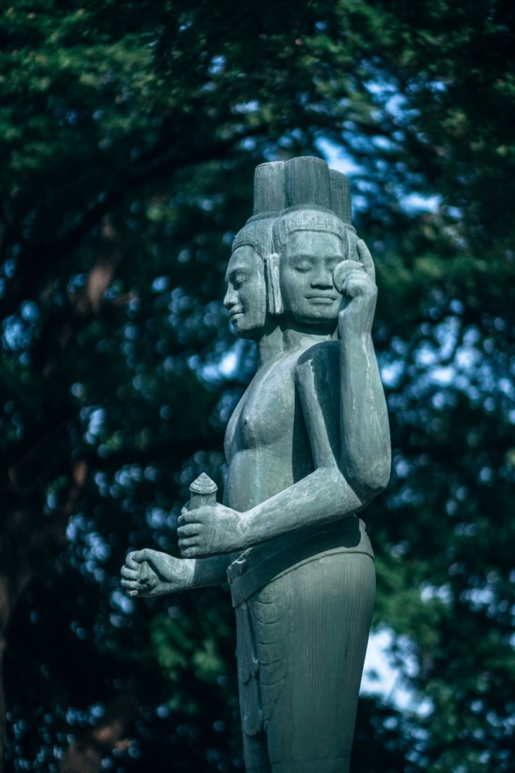 Teal-Colored-Buddhist-Statue-next-to-the-River-in-Siem-Reap