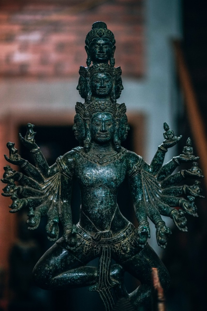 Teal-Statue-of-a-Buddhist-Goddess-with-Multiple-Hands-and-Heads
